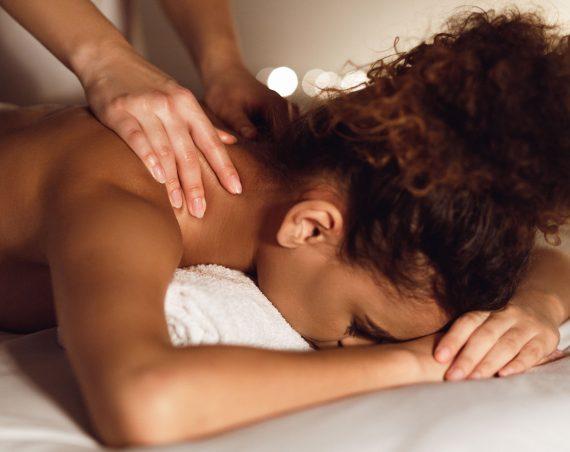 woman-enjoying-therapeutic-neck-massage-in-spa-GMDE84J.jpg